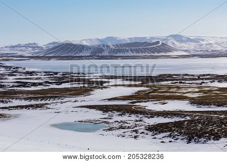 Beautiful winter natural volcano mountain with clear blue sky background Iceland