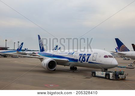 TOKYO JAPAN - SEP132015 : boeing 787 dreamliner of japan airline preparing for departure from narita airport