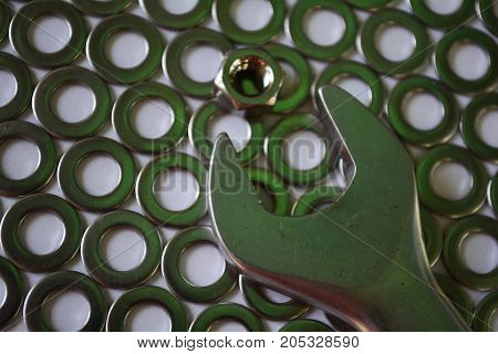 pattern of metal fasteners , spanner and nut