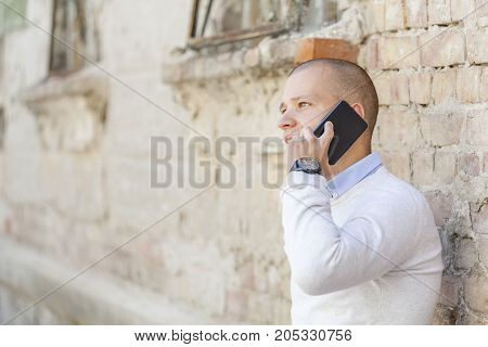 He Talks To His Business Partners Via A Cell Phone