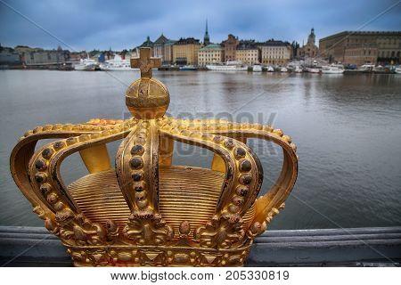 Skeppsholmsbron (Skeppsholm Bridge) with Golden Crown on a bridge in Stockholm Sweden