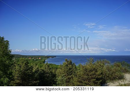 marine landscape with views of a small village surrounded by forests on the Curonian spit in Russia