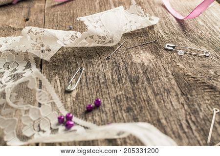 Lace, Beads, Sewing Supplies On Wooden Background. Top View. Flat Lay Composition