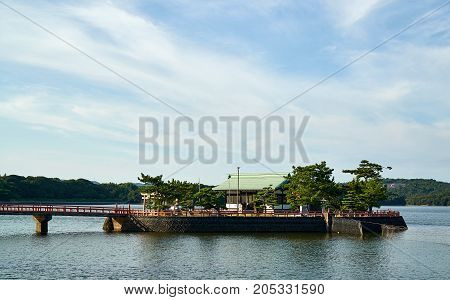 Japanese Temple located in the central of pond in Tokiwa Park, Ube City, Yamaguchi Prefecture, Japan.