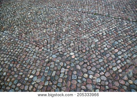 Cobblestone Pavement located on the Slottsbacken street near the Royal Palace in Stockholm Sweden