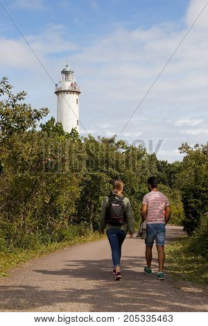 Byxelkrok Sweden - August 22 2017: A couple walking towards the lighthouse Lange Erik at the Swedish province of Oland north end.