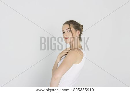 Pretty girl looking with interest on white backgraund