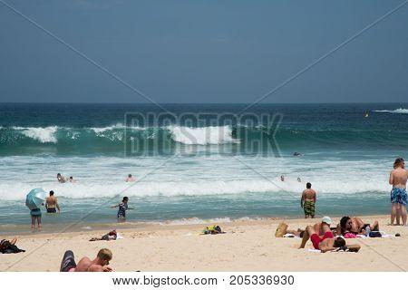 SYDNEY,NSW,AUSTRALIA-NOVEMBER 21,2016: Beachgoers at Bondi Beach on the Pacific Ocean coast in Sydney, Australia.