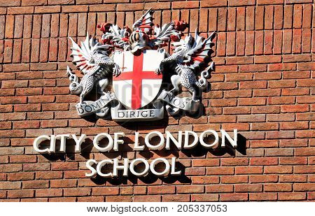City of London School Crest on a london brick wall. It marks the city of London School which is a school for boys beteen the ages of 10 years and 18 years. City of London School is one of London's leading academic day schools. London UK 2017