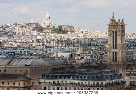 View from the observation deck of the cathedral of Notre Dame at Sacre Coeur and Tour Saint-Jacques. Paris. France