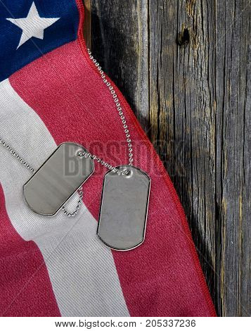 military dog tags and American flag on rustic wood