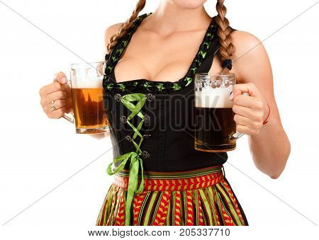 Young sexy Oktoberfest waitress, wearing a traditional Bavarian dress, serving big beer mugs on white background.