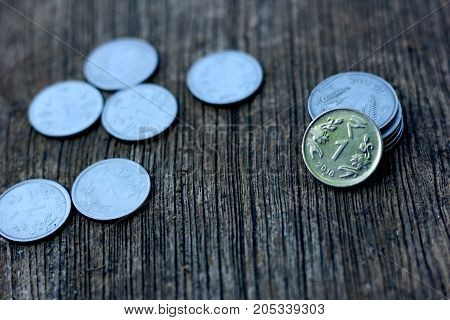 Indian currency coin on wooden texture ,