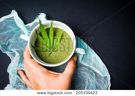 Hand Taking Marijuana Cannabis Powder In A Bowl