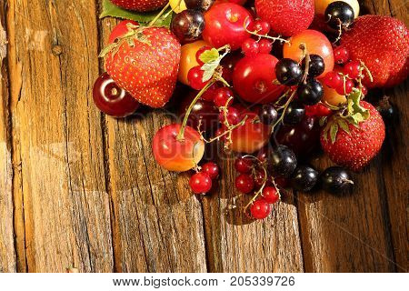fresh berries on an old retro wooden background