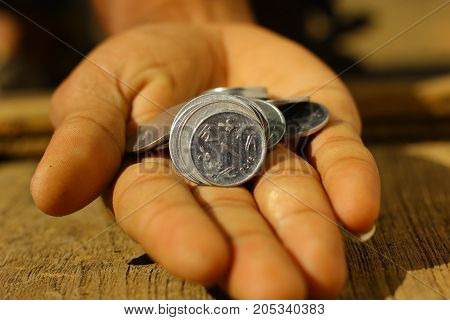 Indian currency coin on hand , Coin