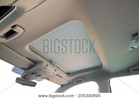 a closed sunroof on a passenger car