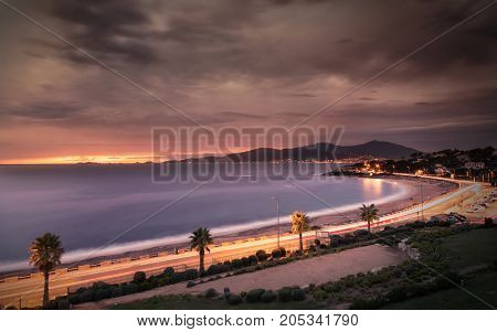 Sunset And Stormy Clouds Over Porticcio Beach In Corsica