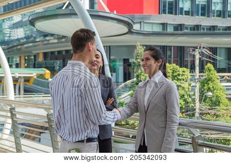 Young businessmen meeting outside the business district.