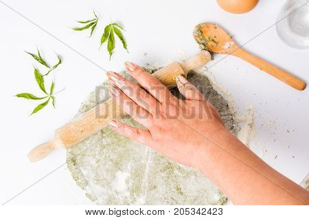 Woman Kneading Dough Of Marijuana And Wheat Flour