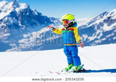Ski And Snow Fun For Child In Winter Mountains