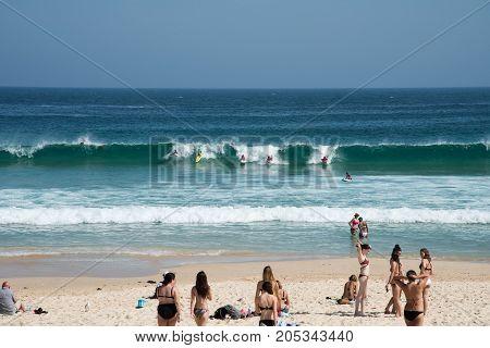 SYDNEY,NSW,AUSTRALIA-NOVEMBER 21,2016: Children surfing and bodyboarding on the Pacific Ocean coast at Bondi Beach in Sydney, Australia.