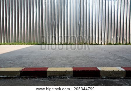 The construction site enclosed metal sheet fence built beside the street footpath