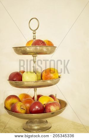 Various of apples in multilevel plate .