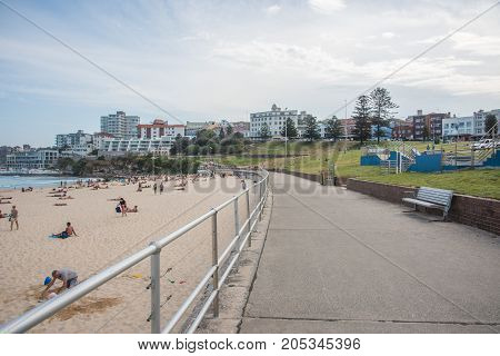 SYDNEY,NSW,AUSTRALIA-NOVEMBER 21,2016: Skate park on the Bondi Beach foreshore with tourists at the beach and waterfront architecture in Sydney, Australia