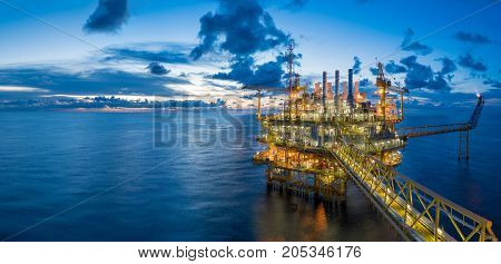 Panorama of Oil and Gas central processing platform in twilight offshore hard work occupation twenty four working hours.