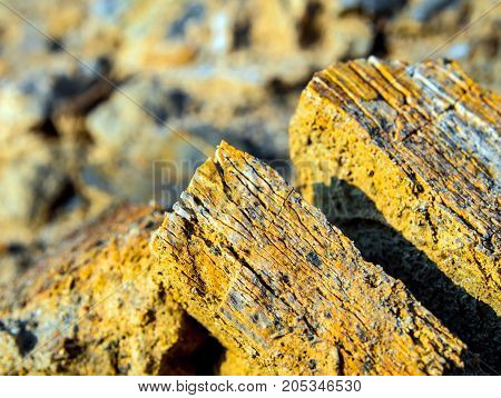 Texture Of Golden Color Stone And Soil On Rocky Mountain Soil