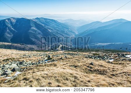 Lift station in Low Tatras mountains. Cable car to the Chopok peak. Valley with coniferous forest. Travelling theme. Natural scene.
