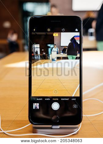 PARIS FRANCE - SEP 22 2017: New iPhone 8 and iPhone 8 Plus as well the updated Apple Watch Apple TV goes on sale today in Apple Store with camera app on the black iphone 8 plus open