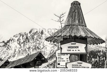 Hiking signs in Hrebienok High Tatras mountains Slovak republic. Winter natural scene. Tourism theme. Black and white photo.