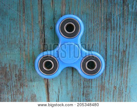 Blue Fidget Spinner Stress Relieving Toy On White Background
