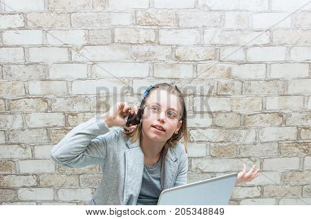 Teen Girl Talking On The Phone On The Wall Background