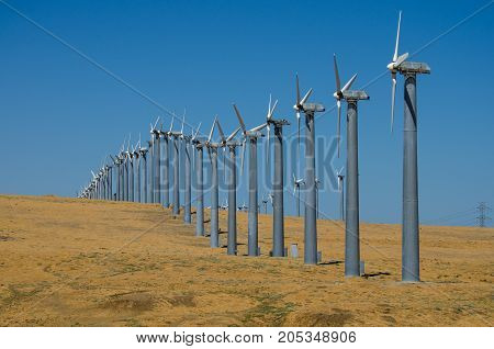 Wind Turbines in a row on the hillside
