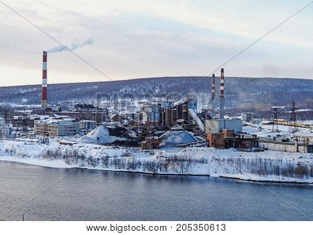 GUBAKHA PERM KRAI RUSSIA - MARCH 1 2017: The view from the top of the mountain at the industrial site of the plant