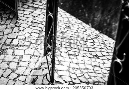 pavement pattern reflecting in mirror in black and white monochrome