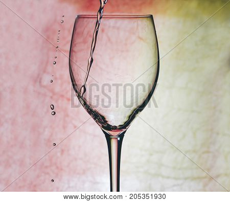 Glass with red wine on the bar table