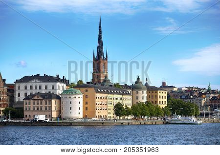 STOCKHOLM SWEDEN - AUGUST 20 2016: Tourists boat and View of Gamla Stan from Stockholm City Hall ( Stadshuset ) in Stockholm Sweden on August 20 2016.