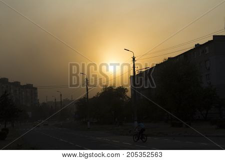 Sunset with dusty wind in the city.