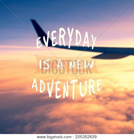 Travel Inspirational Quotes - Everyday Is A New Adventure. Blurry Background.
