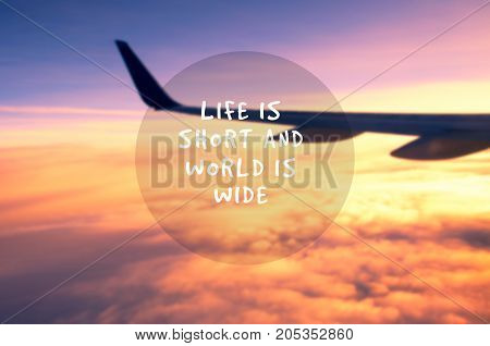 Travel Inspirational Quotes - Life Is Short And World Is Wide. Blurry Background.