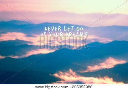 Life Inspirational Quotes - Never Let Go Of Your Dreams. Blurry Background.