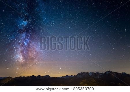 The Colorful Glowing Milky Way And The Starry Sky Over The French Alps And The Majestic Massif Des E