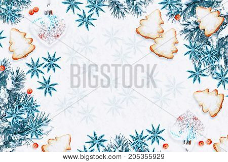 Snow covered trees. Festive Christmas composition. Card. Top view flat lay.