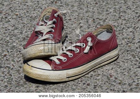 Vintage old maroon red torn canvas teenager sneakers - shoes