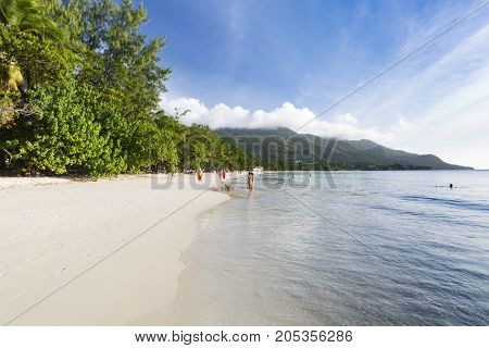 MAHE - AUGUST 08: Tourists and locals at Beau Vallon Beach in the west of Mahe Seychelles on August 08 2014