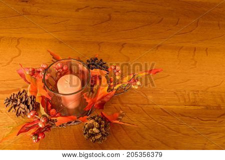Seasonal holiday table decor be it fall, Thanksgiving, Halloween or Christmas with wooden background of oak